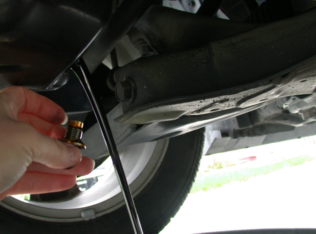 How to change the oil in your car by draining motor oil